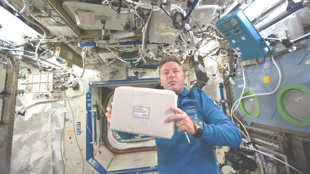 ESA astronaut Roberto Vittori on the International Space Station in 2011 with the air quality control and monitoring system Airgloss NADIR. Photo © NASA